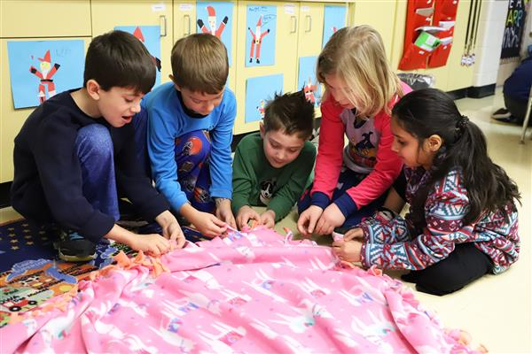 FSD79 second-graders put together 45 blankets to help the homeless this holiday season.